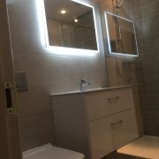 After image - Bathroom renovation, wall hung basin unit, led mirror, wall hung toilet with chrome flush plate - Cleary Bathroom Design