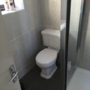 Neutral Bathroom - Dun Laoghaire - Cleary Bathroom Design Featuring a border tile, plain wall tile, dark floor tile, concealed shower valve, close coupled back to wall pan and cistern, concealed shower valve, - Cleary Bathroom Design