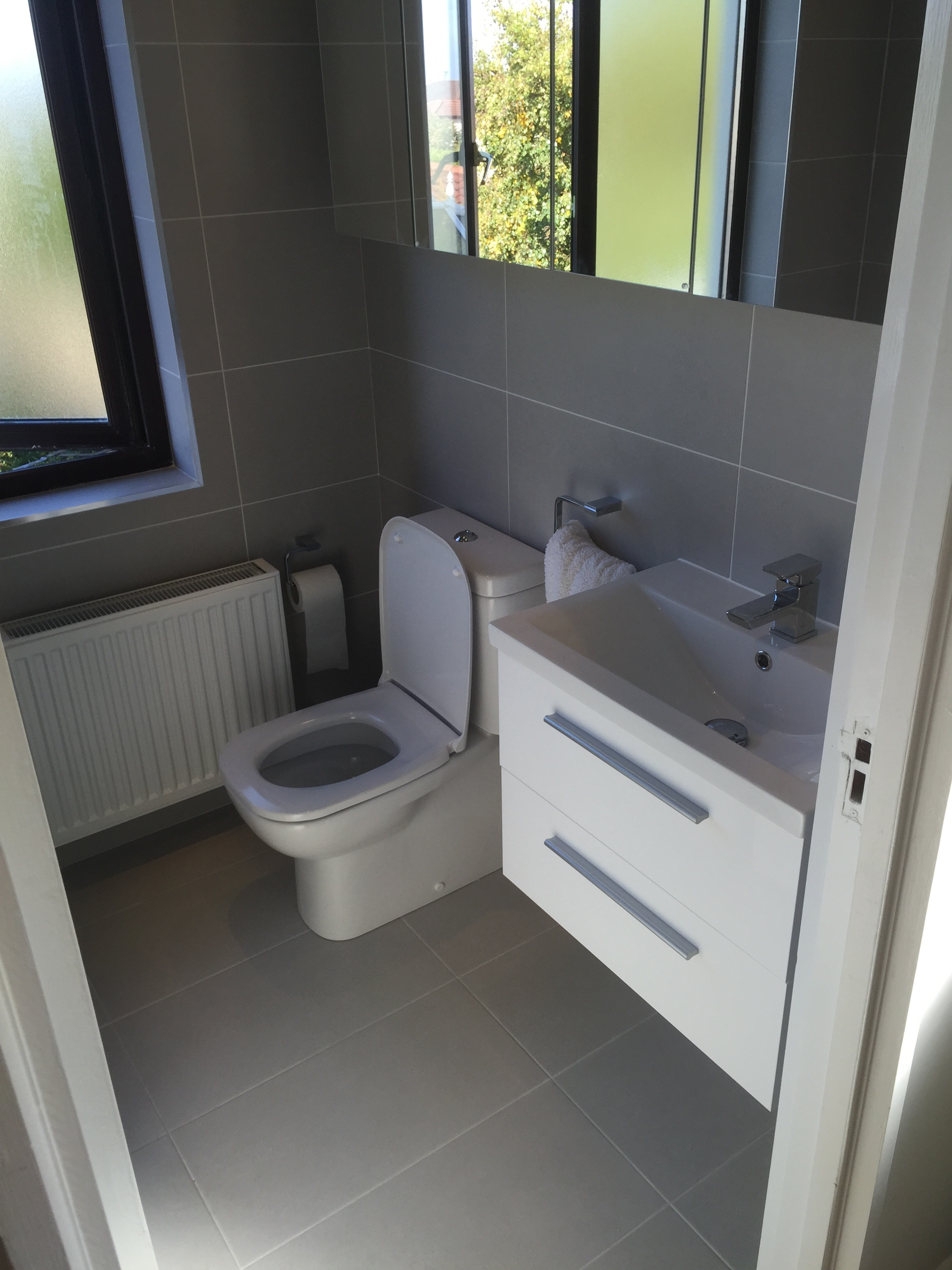 This Beautiful Grey Bathroom Features Close Coupled Back To Wall Pan And Cistern White