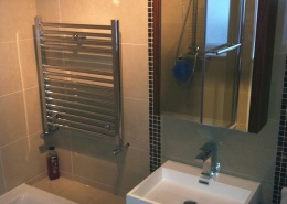 Heated towel rack and sink with under are storage Bathroom renovation - rathcoole - Cleary Bathroom Design