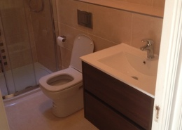 Updated main bathroom completed by Cleary Bathroom Design Features Offset quadrant shower tray and enclosure Wall hung basin unit with drawers in mahogany Back to wall pan with concealed cistern and chrome flush plate