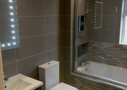 Modern Bathroom Design Bathroom completed by Cleary bathroom design. Modern bathroom uplit bath / shower. Textured floor and wall tiles