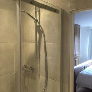 Cleary Bathroom Design - Bray Bathroom With Cream Tiles and chroma shower unit- Dublin