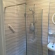 This bathroom now features a walk in shower, beautiful texture wall tiles, basin and pedi, open back toilet and electric shower.