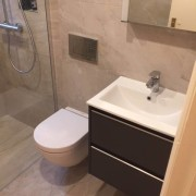 Bathroom by Cleary Bathroom Design Featuring Beige Tiles